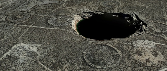 A sinkhole, approximately 300 yards in diameter and 30 yards deep, located in the Permian Basin of western Texas that formed from uncontrolled dissolution of a subsidence salt formation.
